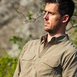 A rugged man wearing a brown khaki shirt