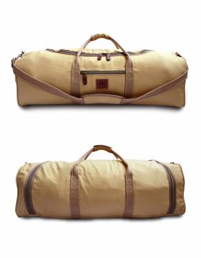 In Safari Tan, this canvas bag offers classic safari styling as a weekender, travel, and everyday bag.