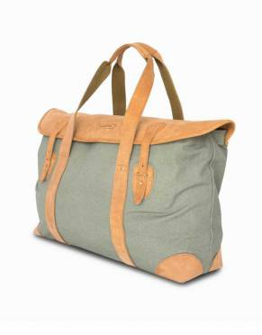 In a subtle green and tan combination, this soft safari bag has a satchel-style leather flap with quick-release brass stud fasteners