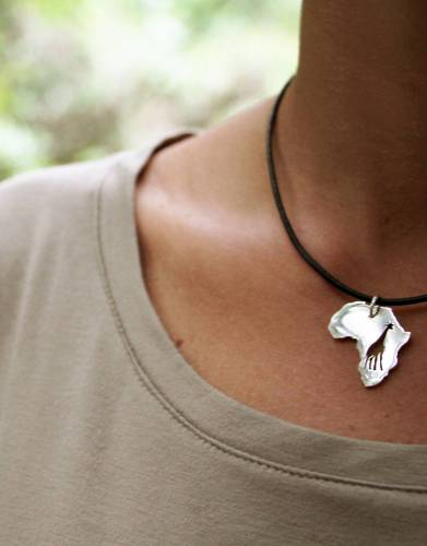 The Giraffe necklace comes with a silver chain and a leather cord so you can match it to your outfit.