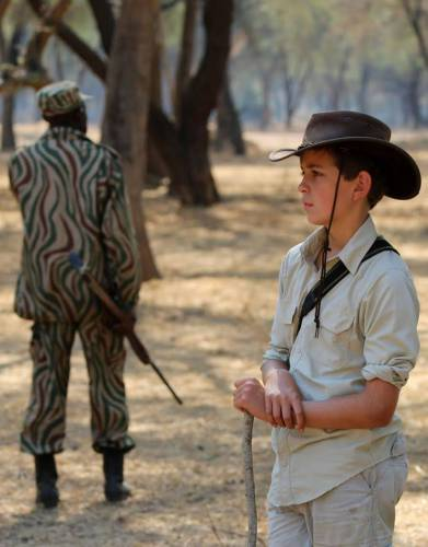 Pictured on safari: Will wearing the Boys' & Girls' Rufiji MaraTech Long-Sleeved Shirt in the the Lower Zambezi. Give your little ones the gift of big adventures with a shirt designed for enjoyment of Africa and the outdoors.