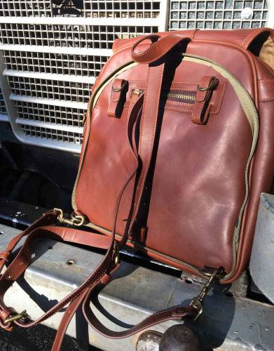 Convert your bag into a luxurious backpack by removing the buckle section of the satchel strap on one end, looping the satchel strap through the D-ring at the top and replacing the buckle section, and clipping both ends on to the D-rings at the bottom.