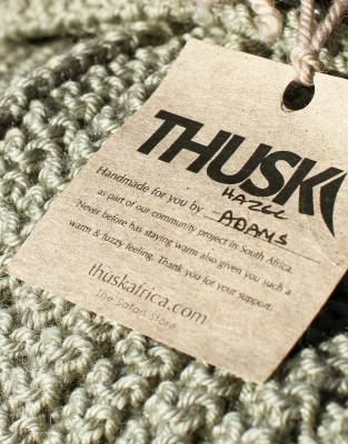 Your Thusk™ Button Scarf has been hand-knitted as part of a community project in South Africa, supplying an income to the female craftswomen behind every Thusk™ creation.