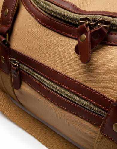 The Rufiji Safari Explorer is multi-pocketed with compartments on each end and a zip pocket on the side.