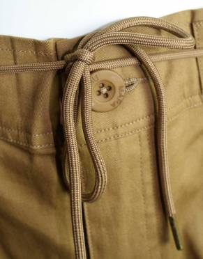 The brass-tipped drawstring assists in giving the best possible fit for travels and activities.