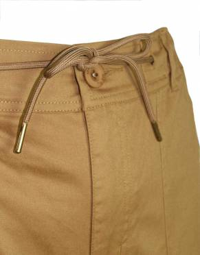 The elasticated waist and brass-tipped drawstring are designed for comfort during outdoor activities, on the plane, and on the back of game-viewers in equal measure