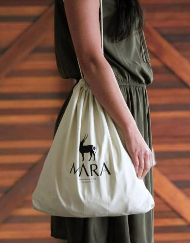 The drawstring bag can be used as a backpack or satchel.