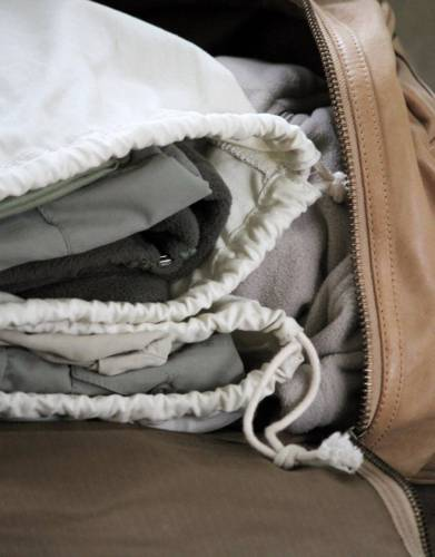 If you own multiple drawstring bags you can separate outfits when you travel.