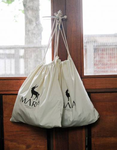 Use multiple drawstring bags for storage solutions in your home and office.