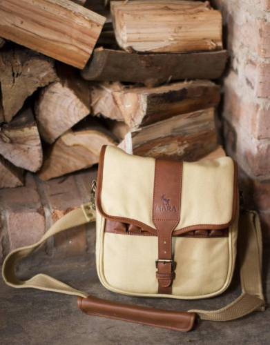 The safari styling of this multi-purpose satchel make it an eye-catching bag for daily use with features that give it practical field use for hobbies and outdoor pursuits