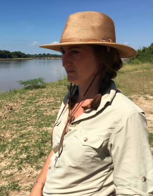 Game-viewing on a hot day across the Luangwa River in South Luangwa National Park. This turned out to be a lucky hat as, just after this photo was taken, our Expedition-Tested crew found a pack of wild dogs and followed them on the hunt for about an hour.