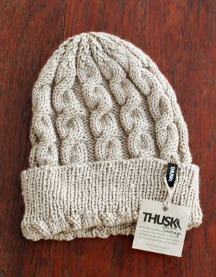 Handmade with love, this classic cable-knit beanie is a time-honoured fashion item and winter essential.