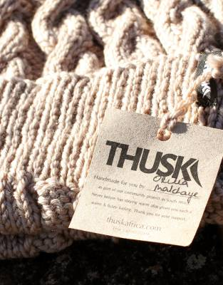 Your Thusk™ Cable-Knit Beanie has been hand-knitted as part of a community project in South Africa, supplying an income to the female craftswomen behind every Thusk™ creation.