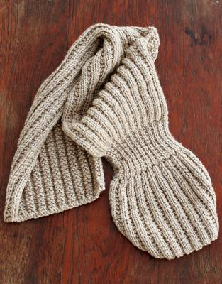 Unfolded, the Thusk™ Bow Scarf can be worn as a traditional ribbed woolen scarf