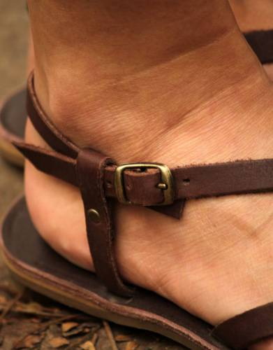The adjustable brass buckle closure is adjustable for fit and provides a stylish detail to the overall look of the sandals.