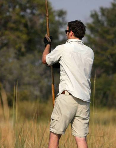 Safari Steve poling a mokoro in the Okavango Delta - the ultimate expedition test!