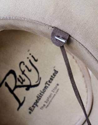 Attach the neck cord to the Rufiji™ Canvas Explorer Hat via the discreet leather tabs on the inside of the hat.