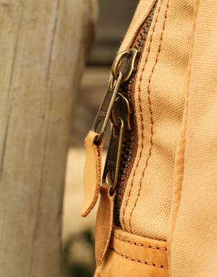 Solid brass fittings throughout with leather tabs on the zips for comfort and grip.