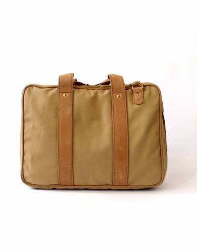 In hardy, stylish canvas with leather accents, the Sandstorm Tracker Bag is an eye-catching alternative to the traditional briefcase or laptop bag.