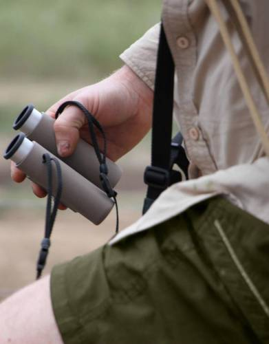 Wildlife artist Brent Dodd using the Swarovski CL Pocket binoculars in the iMfolozi Game Reserve. Their small and compact build makes them easy and lightweight to carry on walks.