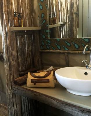 Right at home on safari, the Rufiji™ Explorer Washbag shows off safari travel style at Hyena Pan in Khwai Private Game Reserve, Botswana
