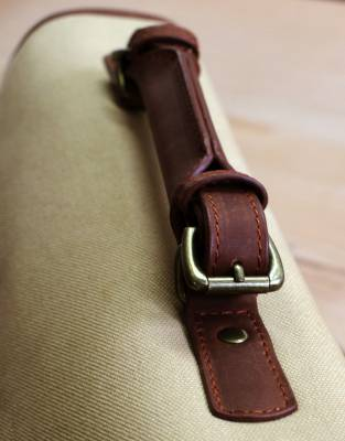 A comfort-grip detachable leather handle gives you the option of turning the satchel into a briefcase.