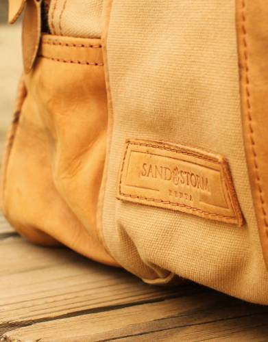 Made from specially tanned camel and cowhides with safari-grade 100% cotton canvas.