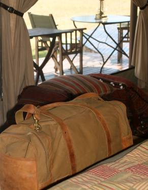 At home in Africa, the Sandstorm Pioneer Bag brings elegant safari styling to your travels. Pictured here at Singita Faru Faru Lodge.
