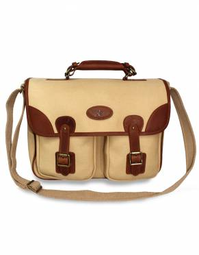 Worn as a shoulder bag using the adjustable canvas shoulder strap or carried as a briefcase, this satchel is evocative of early expedition bags.