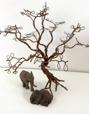Elephants under a tree. Mags Scott sent us this African scene created with her snare tree, adding a touch of rustic charm to her decor.