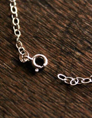 The necklace has a secure clasp that fits into any of the links on the chain allowing you to adjust it accordingly.