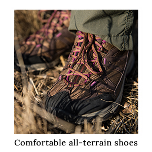 A woman's feet, wearing Merrell Safari Trail Shoes and safari trousers on safari in Africa