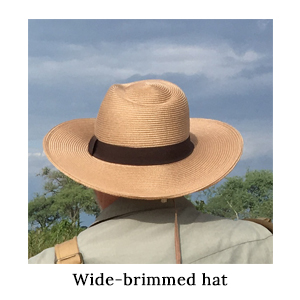 A wide-brimmed hat is a walking safari essential. The Mara&Meru Panama Safari Hat on a walking safari in Africa
