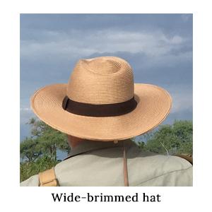 A wide-brimmed hat is a walking safari essential. The Mara&Meru Panama Safari Hat on a walking safari in Africa