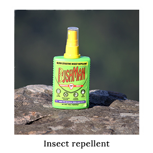 A bottle of Australian-made Bushman Pump Spray insect repellent on a rock for insect protection on safari in Africa