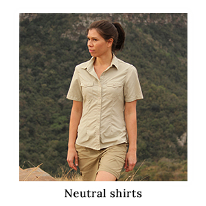 A woman in a neutral-coloured safari shirt made from insect repellent technical fabric on safari in Africa