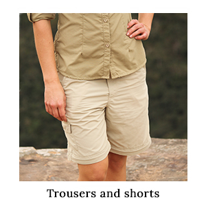 A woman wearing zip-off safari trousers in technical fabric converted into shorts on safari in Africa