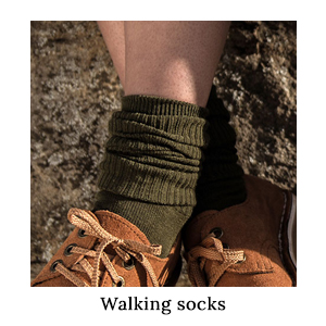 A pair of woman's feet dangling over a rock, wearing a pair of 1000Mile Blister-Free Safari Socks on a walking safari