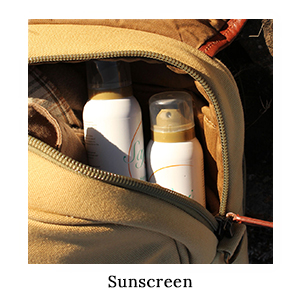 A canvas and leather bag with two bottles of SafariSUN sunscreen spray for sun protection when running on safari in Africa
