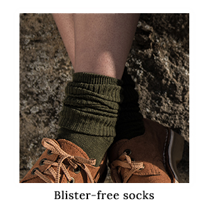 Woman's feet dangling over a rock in a pair of 1000Mile Blister-Free Safari Socks and shoes on safari in Africa