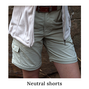 A woman wearing a pair of neutral-coloured safari zip-off trousers converted into safari shorts on safari in Africa