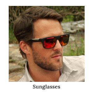 A man wearing a pair of Bolle sunglasses to protect his eyes from the harsh sun on a walking safari in Africa