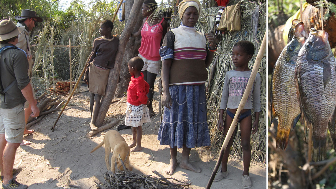 Bayei women and children with a puppy in a Botswana village in the Okavango Delta where they fish for a living.