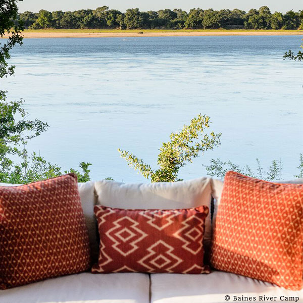 Couch cushions in front of the view of the Zambezi River and bush on safari at Baines' River Camp, Lower Zambezi, Zambia