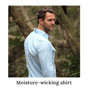 A man looking back over his shoulder in a blue outdoor shirt made from insect repellent, moisture wicking technical fabric