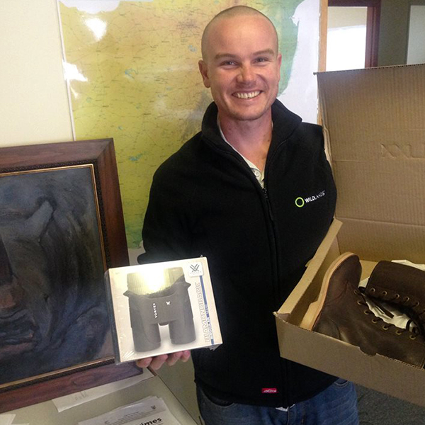 Dave Gilory from Somkhanda Game Reserve accepting the boots and binoculars with a smile.