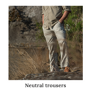 A man wearing safari trousers in a neutral, safari-friendly colour and made from insect repellent ripstop fabric in Africa