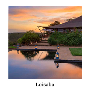 A colourful sunset view over the bush, safari lodge, and a pool lined with hurricane lamps at Loisaba in Kenya
