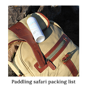 A canvas and leather safari satchel with a bottle of SafariSUN sunscreen – one of the essentials to pack for paddling safaris