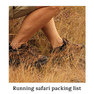 Man's legs in Merrell Moab Ventilator trail running shoes in the grass – one of the packing essentials for running on safari
